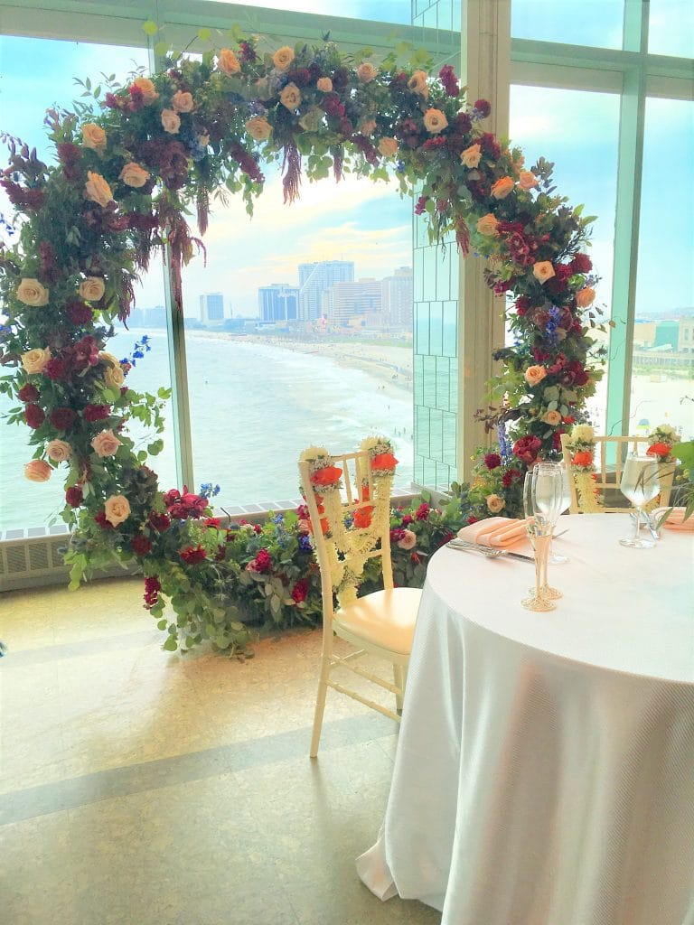 Circle Arch behind Sweetheart table 768x1024 - Atlantic Room